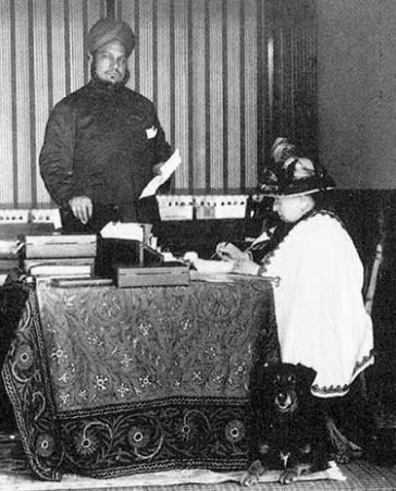 The real Queen Victoria and Abdul Karim at the Queen's writing desk