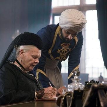 Dench and Fazal at the Queen's writing desk